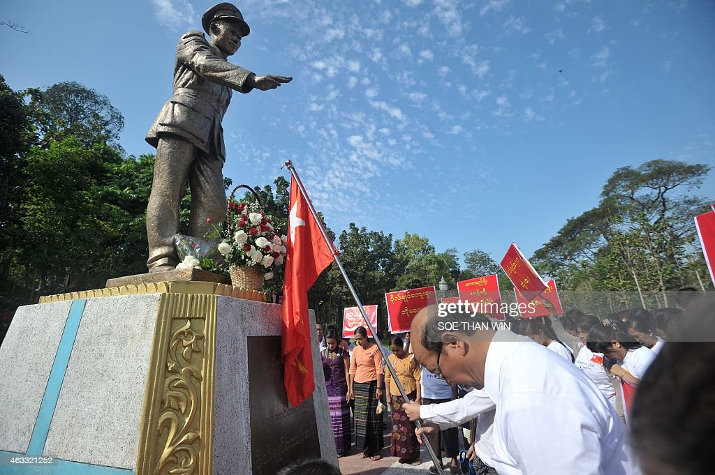 Members of the National League for Democracy (NLD) pay their respects to late General <a gi-track='captionPersonalityLinkClicked' href=/galleries/search?phrase=Aung+San&family=editorial&specificpeople=812845 ng-click='$event.stopPropagation()'>Aung San</a> statue to mark the 100th birthday of independence hero <a gi-track='captionPersonalityLinkClicked' href=/galleries/search?phrase=Aung+San&family=editorial&specificpeople=812845 ng-click='$event.stopPropagation()'>Aung San</a>, in Yangon on February 13, 2015. Known affectionately as 'Bogyoke', or General, <a gi-track='captionPersonalityLinkClicked' href=/galleries/search?phrase=Aung+San&family=editorial&specificpeople=812845 ng-click='$event.stopPropagation()'>Aung San</a> is adored in Myanmar and credited with unshackling the country from colonial rule and embracing its ethnic minorities in a vision of unity that unraveled catastrophically in the military-dominated decades that followed his 1947 assassination.