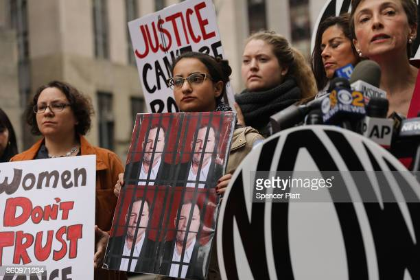 Members of the National Organization for Women hold a news conference and demonstration outside of Manhattan Criminal Court where Cyrus R Vance Jr...