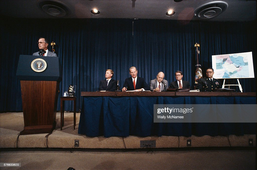 Members of the National Security Council discuss the situation in the Persian Gulf after Iran's invasion of Kuwait From left to right President...