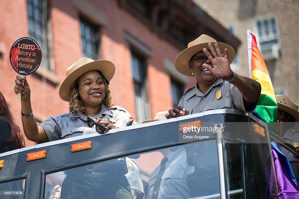 Members of the Nationals Park Service wave to the crowd as they ride on a bus on Christopher Street during the New York City Pride March, June 26, 2016 in New York City. This year was the 46th Pride march in New York City.