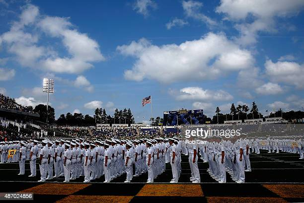 Members of the Navy Midshipmen line the field before the start of their game against the Colgate Raiders at NavyMarine Corps Memorial Stadium on...