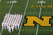 Members of the Navy Midshipmen line up before the start of their game against the Rutgers Scarlet Knights at Navy Marine Corps Memorial Stadium on...