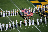 Members of the Navy Midshipmen take the field before the start of their game against the Rutgers Scarlet Knights at Navy Marine Corps Memorial...