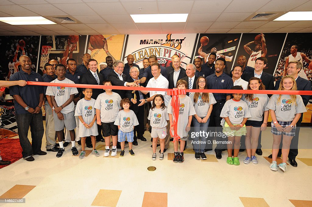 Members of the NBA and Miami Heat family including executives, players and Miami Community leaders gather for a ribbon cutting during the unveiling of the NBA Cares Learn and Play Center at the Miami Springs Community Center presented by HP and State Farm on June 18, 2012 in MIami, Florida.