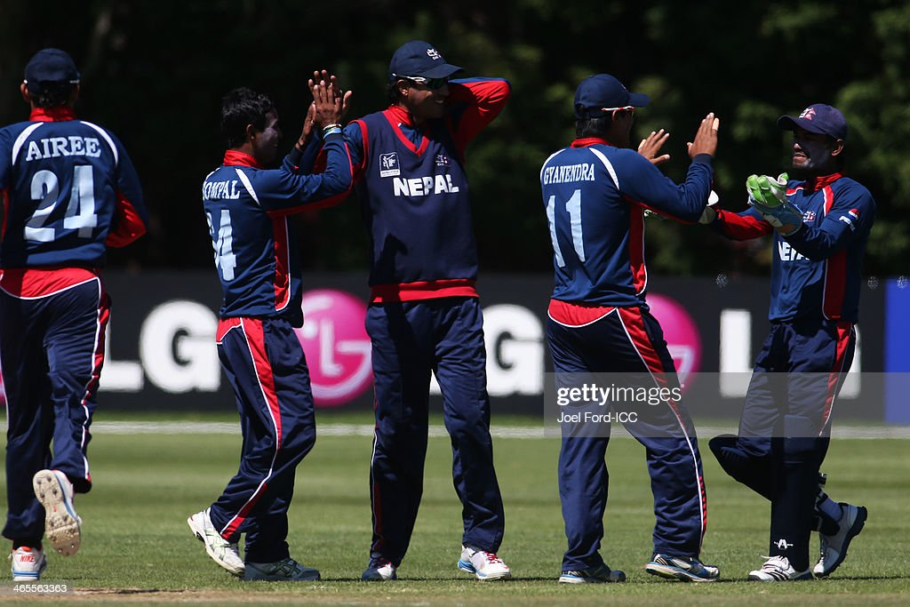 Members of the Nepal cricket team celebrate an out during an ICC World Cup qualifying playoff between Uganda and Nepal on January 28, 2014 in Mount Maunganui, New Zealand.