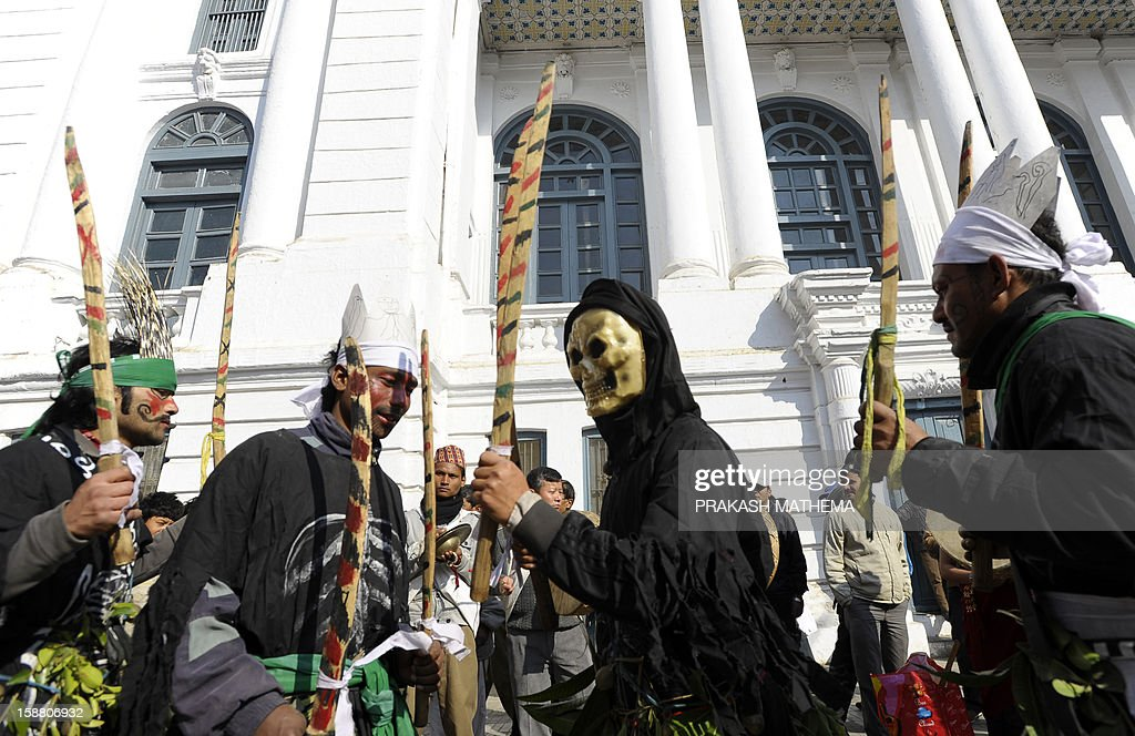 Members of the Nepalese indigenous Gurung community take part in a New Years celebration ceremony known as 'Tamu Lhosar ' in Kathmandu on December 30, 2012, held to celebrate their New Year or Lhosar. Gurungs number some 700,000 people about three percent of the Himalayan nation's population and are mainly concentrated in the country's central region. AFP PHOTO/Prakash MATHEMA