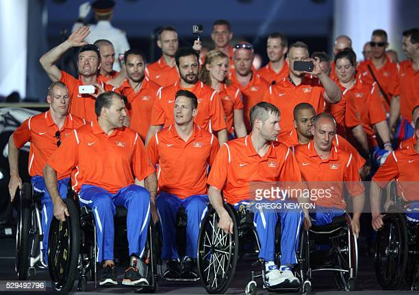 Members of the Netherlands team parade into the stadium during opening ceremonies for the 2016 Invictus Games in Orlando Florida May 8 2016 The...