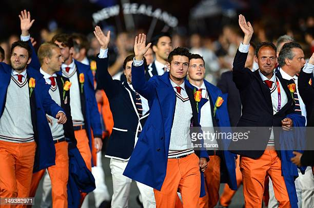 Members of the Netherlands team parade through the stadium during the Opening Ceremony of the London 2012 Olympic Games at the Olympic Stadium on...