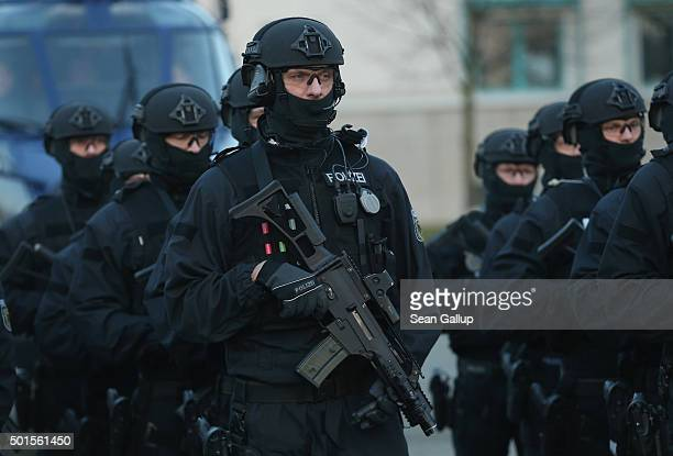 Members of the new BFEplus antiterror unit of the German federal police holding G36C automatic weapons stand at attention after they took part in a...