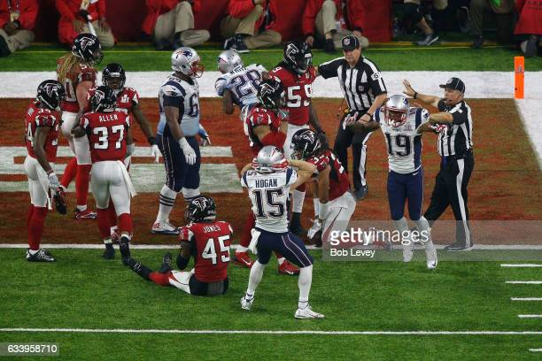 Members of the New England Patriots celebrate after defeating the Atlanta Falcons 3428 in overtime during the Pepsi Zero Sugar Super Bowl 51 Halftime...