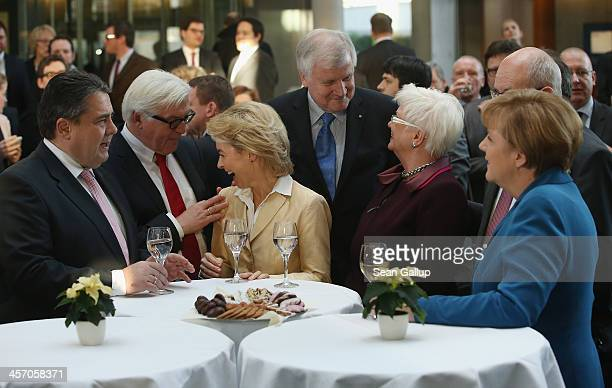 Members of the new German coalition government including Angela Merkel Chancellor and Chairwoman of the German Christian Democrats and Sigmar Gabriel...