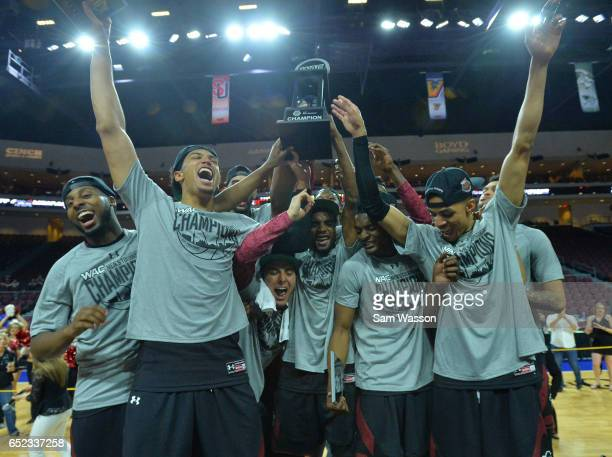 Members of the New Mexico State Aggies celebrate after defeating the Cal State Bakersfield Roadrunners 7060 to win the championship game of the...