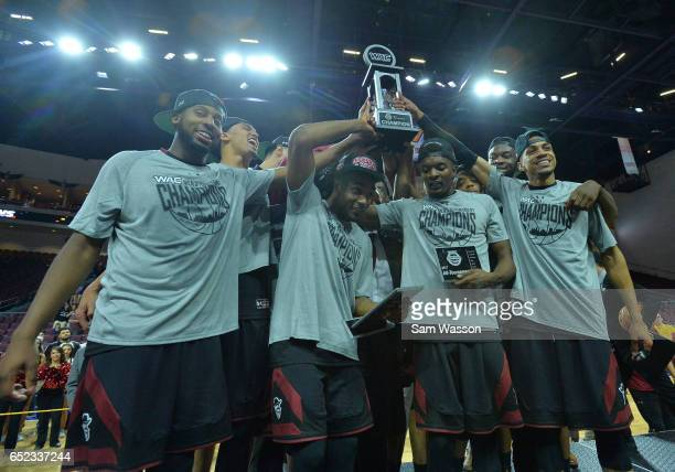 Members of the New Mexico State Aggies celebrate with the trophy after defeating the Cal State Bakersfield Roadrunners 7060 to win the championship...