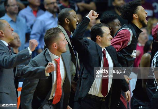 Members of the New Mexico State Aggies coaching staff including head coach Paul Weir celebrate during the championship game of the Western Athletic...
