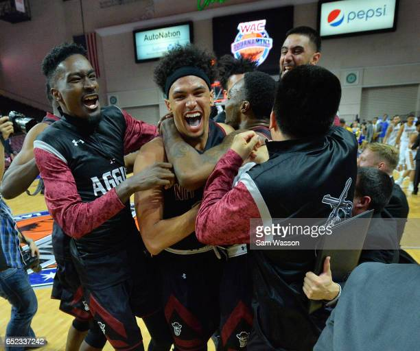 Members of the New Mexico State Aggies including Jalyn Pennie and Eli Chuha celebrate after defeating the Cal State Bakersfield Roadrunners 7060 to...