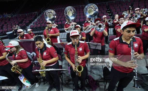 Members of the New Mexico State Aggies pep band perform before the championship game of the Western Athletic Conference Basketball tournament against...