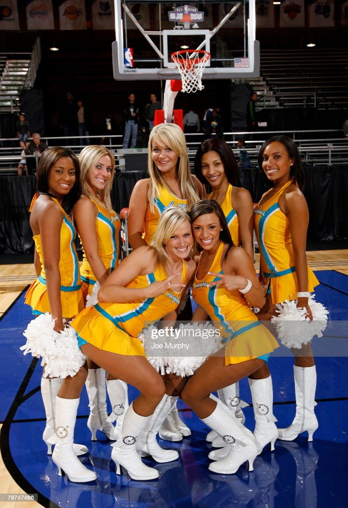 Members of the New Orleans Hornets dance team 'The Honeybees' pose for a photograph on center court during NBA Jam Session Presented by Adidas on...