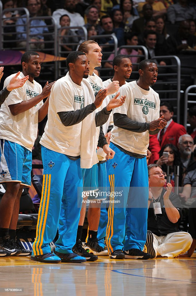 Members of the New Orleans Hornets look on and cheer from the bench against the Los Angeles Lakers at Staples Center on April 9, 2013 in Los Angeles, California.