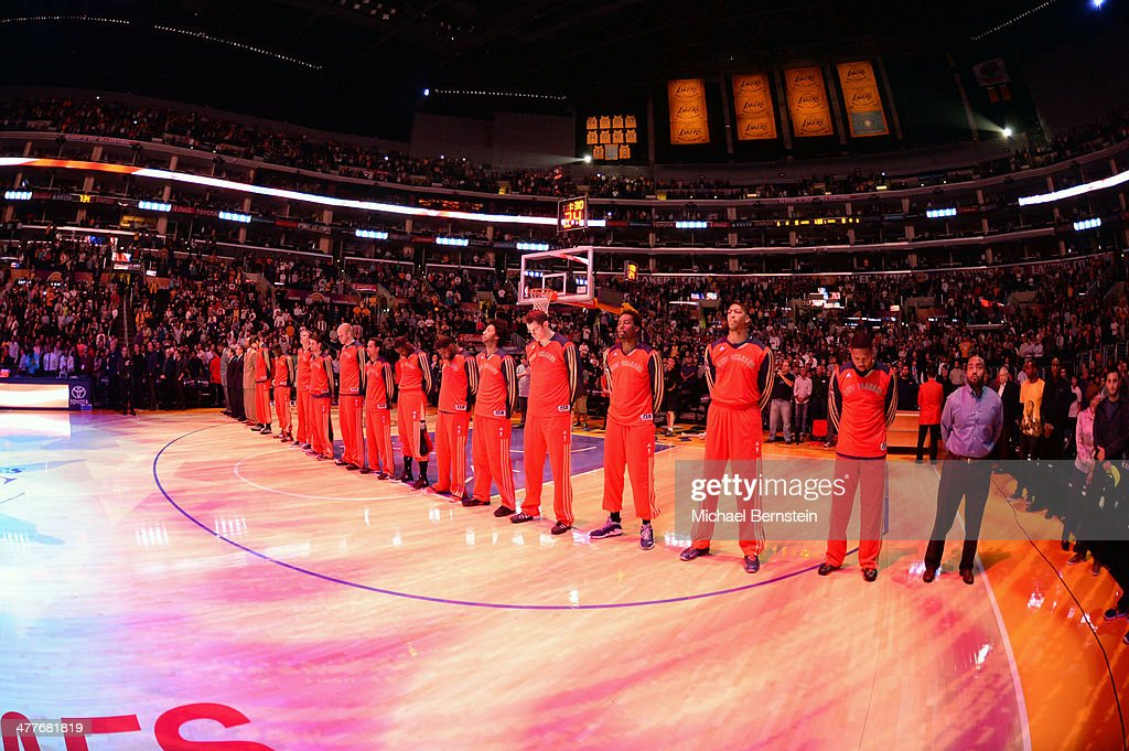 Members of the New Orleans Pelicans stand in observance of the national anthem before a game against the Los Angeles Lakers at Staples Center on November 12, 2013 in Los Angeles, California.