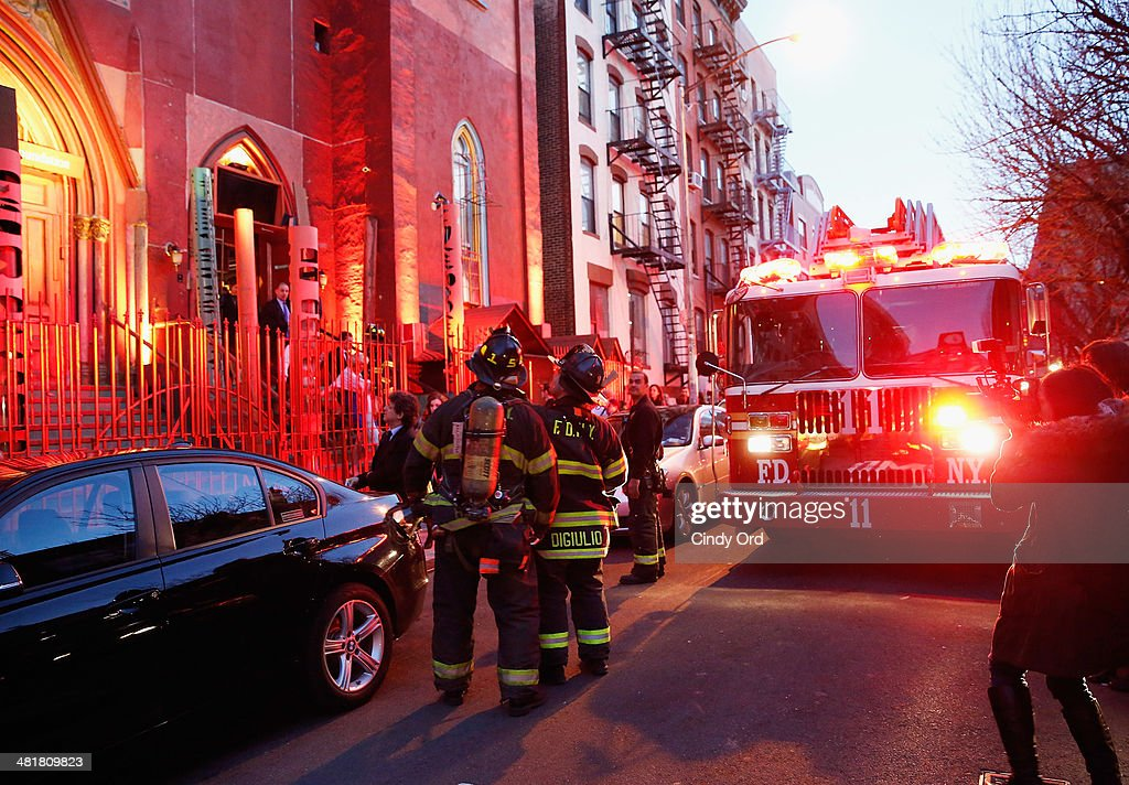Members of the New York City Fire Department are seen assisting in an evacuation of guests during Soho Rep's 2014 Spring Fete at the Angel Orensanz Center after some structural issues were discovered in the building on March 31, 2014 in New York City. Approximately 300 people had to be evacuated from the Angel Orensanz Center after several columns were discovered to have cracks, however there were no injuries reported and the benefit continued outdoors.