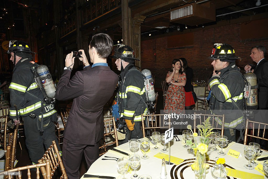 Members of the New York City Fire Department are seen entering Soho Rep's 2014 Spring Fete at the Angel Orensanz Center after some structural issues were discovered in the building on March 31, 2014 in New York City.