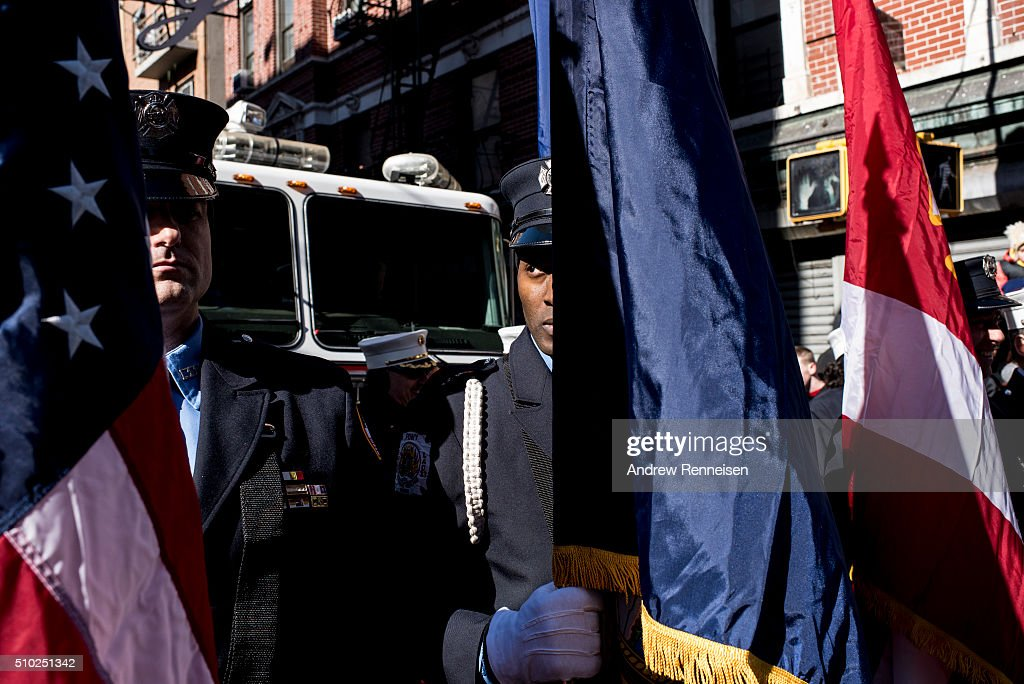 Members of the New York City Fire Department hold flags before the Lunar New Year's parade in Chinatown in New York City on February 14, 2016. The new year starts the year of the monkey.