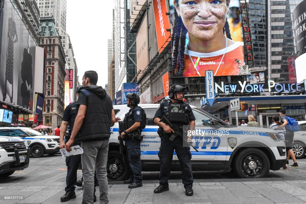 Members of the New York City Police Counterterrorism force stand guard in Times Square on August 18, 2017 in New York City. The NYPD has increased security around New York City after the terror attacks in Spain.