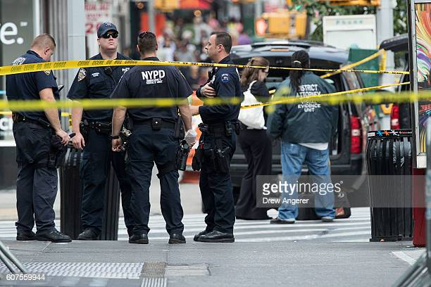 Members of the New York City Police Department and other law enforcement officials work at the scene of Saturday night's explosion in the Chelsea...
