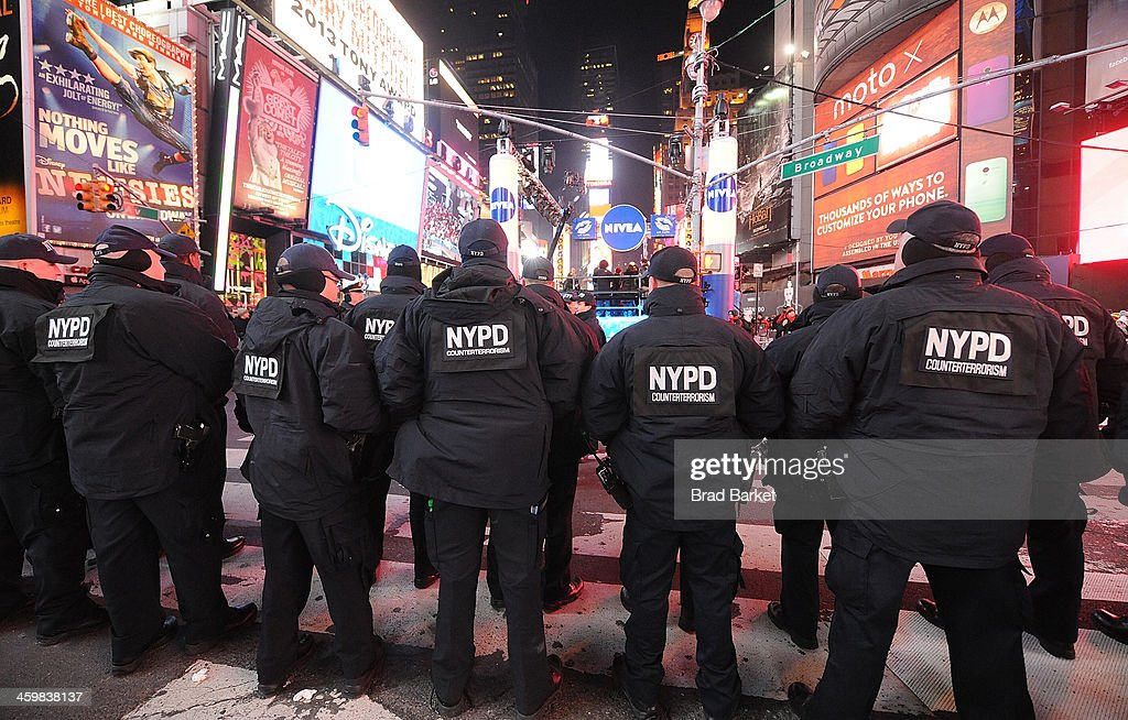 Members of the New York City Police Department attend New Year's Eve 2013 With Carson Daly in Times Square on December 31 2013 in New York City