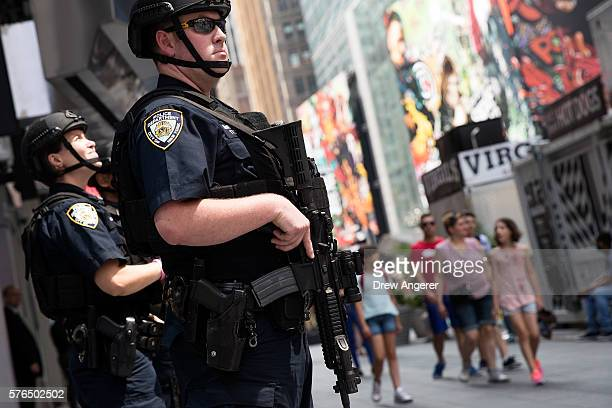 Members of the New York City Police Department stand guard in Times Square July 15 2016 in New York City Following the terrorist attack in Nice...