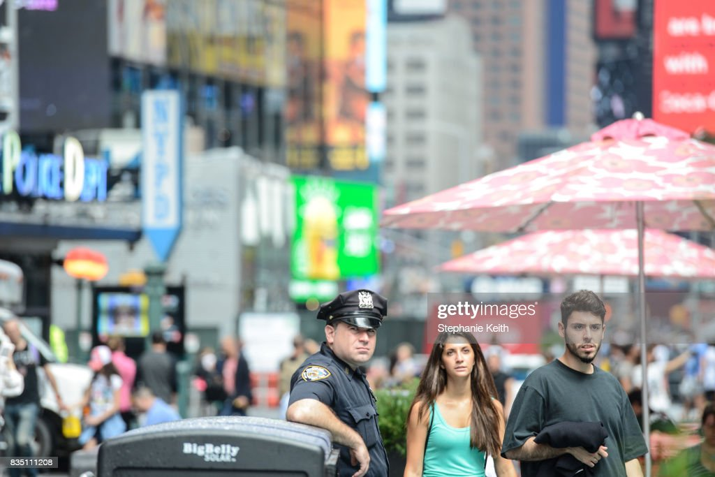 Members of the New York City Police stand guard in Times Square on August 18, 2017 in New York City. The NYPD has increased security around New York City after the terror attacks in Spain.