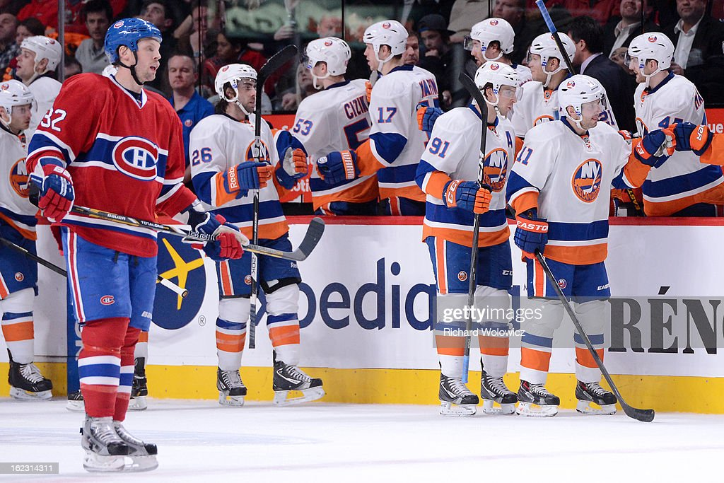 Members of the New York Islanders celebrate a second-period goal by Matt Moulson #26 during the NHL game against the Montreal Canadiens at the Bell Centre on February 21, 2013 in Montreal, Quebec, Canada.