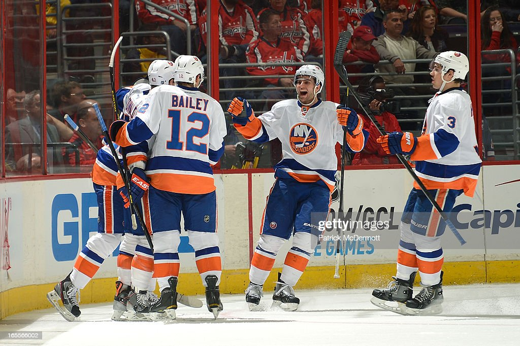 Members of the New York Islanders celebrate following a third-period goal from <a gi-track='captionPersonalityLinkClicked' href=/galleries/search?phrase=Kyle+Okposo&family=editorial&specificpeople=540469 ng-click='$event.stopPropagation()'>Kyle Okposo</a> #21 against the Washington Capitals at Verizon Center on April 4, 2013 in Washington, DC.