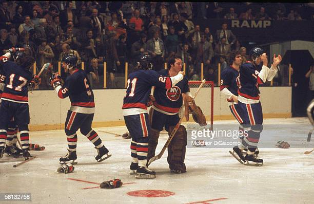 Members of the New York Islanders including Denis Potvin goalie Billy Smith Clark Gillies and Bob Bourne celebrate their overtime victory against...