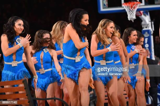 Members of the New York Knicks City Dancers perform against the Atlanta Hawks at Madison Square Garden on December 10 2017 in New York New York NOTE...