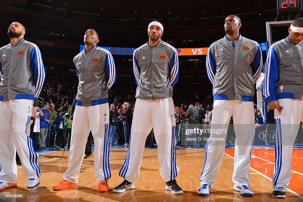 Members of the New York Knicks stand for the National Anthem before the game against the Philadelphia 76ers on February 24, 2013 at Madison Square Garden in New York City, New York.