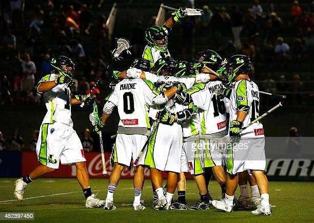 Members of the New York Lizards celebrate following their overtime win against the Boston Cannons during the game at Harvard Stadium on July 19 2014...