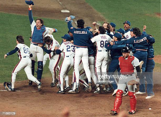 Members of the New York Mets baseball team celebrate their victory in game six of the World Series at Shea Stadium Flushing New York October 25 1986...