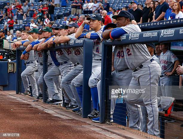 Members of the New York Mets pause to watch the pregame memorial ceremonies for 9/11/2001 before the game against the Atlanta Braves at Turner Field...