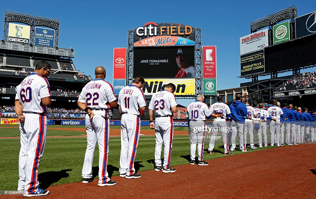 Members of the New York Mets stand for a moment of silence in honor of for Jose Fernandez of the Miami Marlins prior to taking on the Philadelphia Phillies at Citi Field on September 25, 2016 in the Flushing neighborhood of the Queens borough of New York City. Fernandez died earlier in the day in a boating accident.
