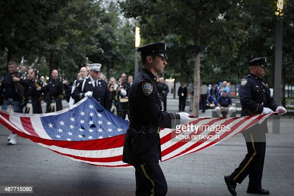 Members of the New York Police department attend a rehearsal at the 9/11 memorial before the ceremony to commemorate the 14th Anniversary of the...