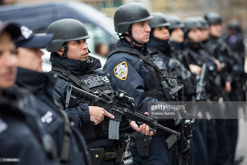 Members of the New York Police Department Strategic Response Group which is funded in part through the Urban Area Security Initiative grant stand...