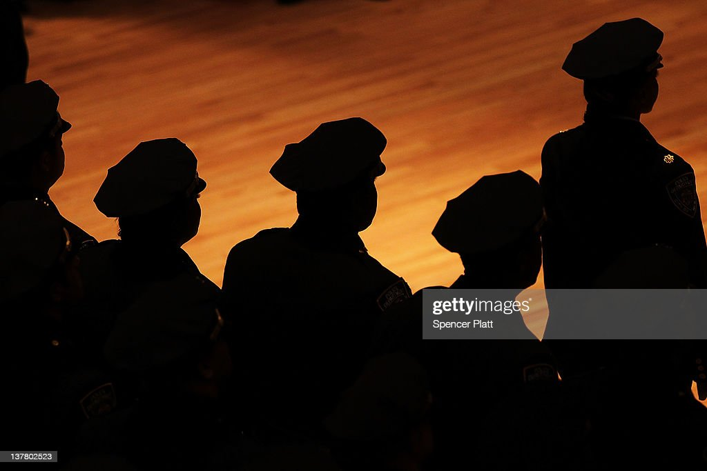 Members of the New York Police Department take part in a promotion ceremony attended by New York City Police Commissioner Raymond Kelly at Police...