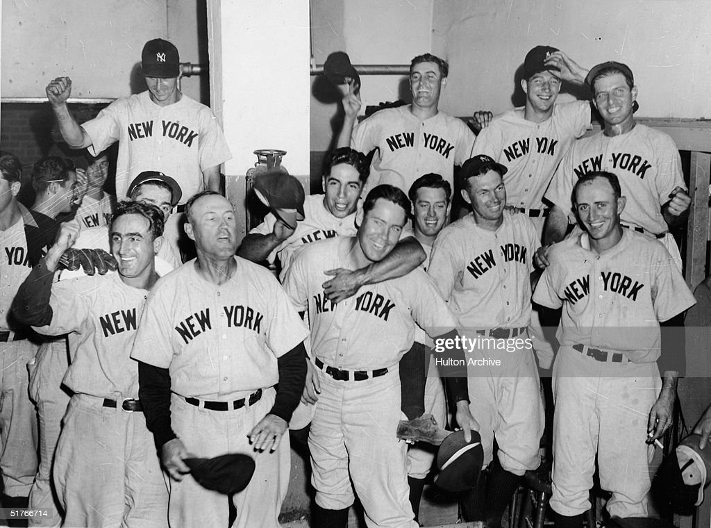 Members of the New York Yankees celebrate a victory over the Boston Red Sox at Fenway Park Boston Massachusetts September 4 1941 Players include...