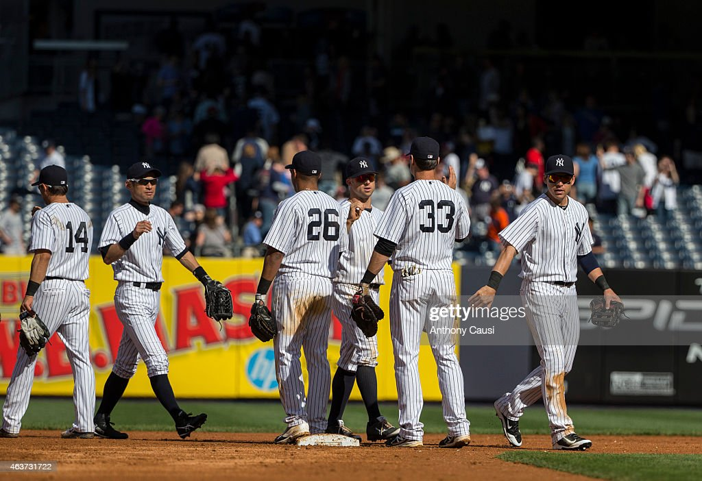 Members of the New York Yankees celebrate defeating the Minnesota Twins at Yankee Stadium on Saturday, May 31, 2014 in the Bronx borough of New York City.