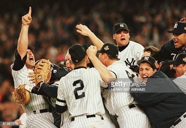 Members of the New York Yankees celebrate on the pitchers mound after beating the Atlanta Braves to win the World Series at Yankee Stadium in New...
