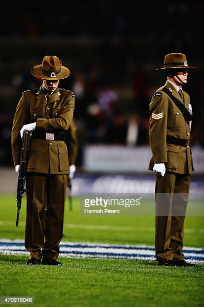 Members of the New Zealand Army observe a moment of silence to mark the significance of Anzac Day prior to the round 11 Super Rugby match between the...