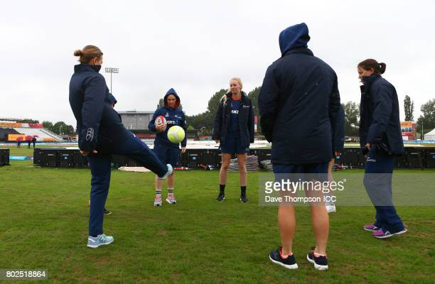Members of the New Zealand cricket team kick a football during the ICC Women's World Cup match between South Africa and New Zealand at The 3aaa...