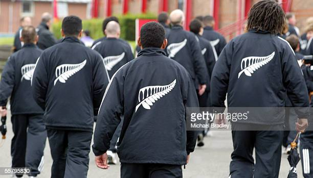 Members of the New Zealand team walk back to their quarters after the New Zealand Flag raising ceremony at the Athletes Village prior to the start of...
