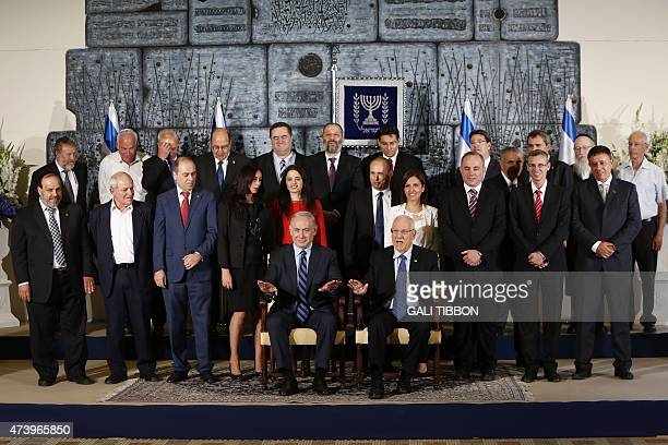 Members of the newly sworn in 34th government of Israel pose for a group photo at the presidential compound in Jerusalem on May 19 2015 Israeli...